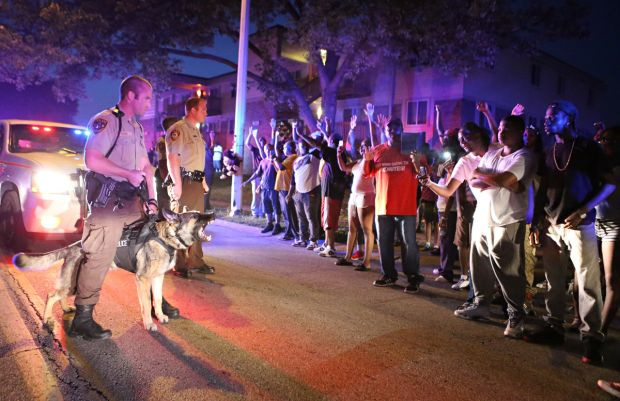 Police used dogs to menace the crowd into the evening. Ferguson, Missouri, Aug. 10, 2014. (Source: David Carson / St. Louis Post-Dispatch)